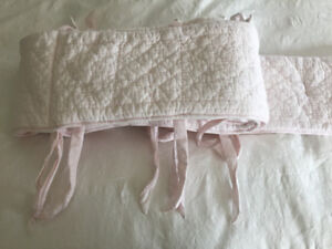 Pink bumper pads and grey crib skirt