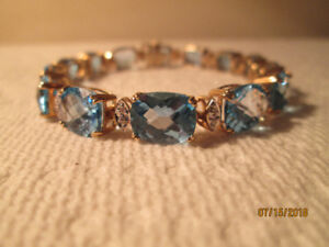 Natural Blue topaz and diamonds bracelet and ring. (On sale  )