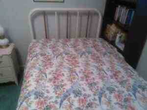 Bed with headboard. Box spring and mattress.
