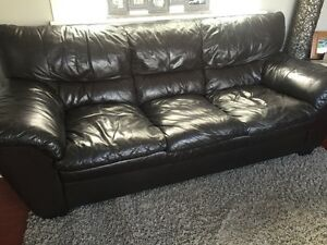Brown leather couch, loveseat and ottoman