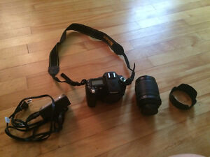Nikon D90 with lens, battery, charger and carrying case