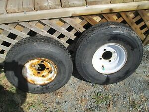 "TWO 8"" TRAILER TIRES ON RIMS."