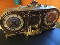 Antique clock and barometer and deco fireplace