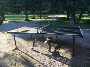 Ping pong table with rackets and balls