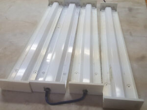 4 commercial Fluorescent lights for sale.