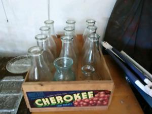Glass milk jugs.