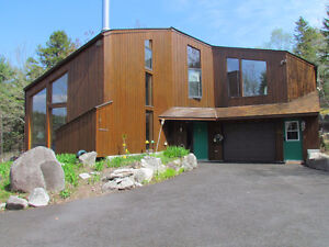 Porter's Lake!293 ft. Waterfront,2 Garages,Boathouse,Over 1 Acre