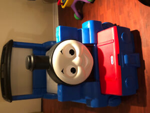 Thomas bed with book shelf/ toy box. Mattress included .
