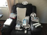 Nintendo wii in white with various accessories