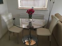 Dining room / kitchen glass top table & 2 cream let her chairs