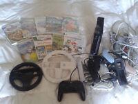 Wii Noire avec beaucoup de manettes, accessoires et 6 jeux