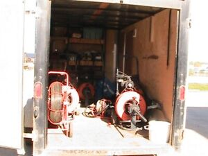 Sewer line cleaning equipment