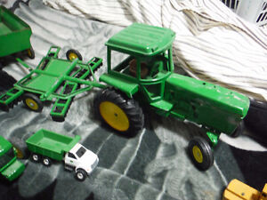 john deere toy tractors and wagons and some other stuff London Ontario image 3