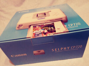 SELPHY CP720 (photo printer) unused $100