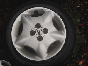 Nearly new winters on rims w/ hubcaps 195/55R15
