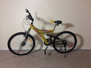 "Two 21spd 24"" Glacier Trax Mountain Bikes with dual shocks"