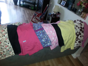 Scrub tops and bottoms size lrg and xlrg. In very good shape .