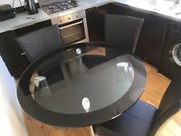 Harvey's black glass table and 4 chairs
