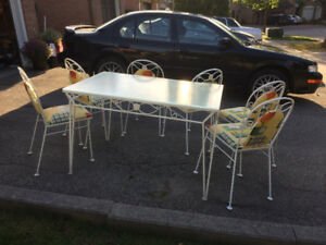 PRICE REDUCED  kitchen table wrought iron glass top w/six chairs