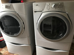 Front load washer and dryer set with pedestals