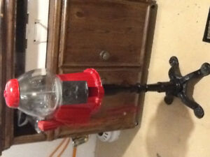 Coin-operated glass & cast iron gum ball machine with phone
