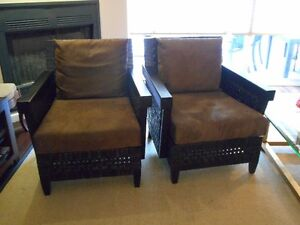 Two Leather Woven Sided Arm chairs.