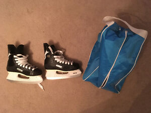 Bauer Impact 100 Tuuk Fasteel Skates with carry bag