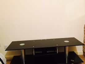 """Black Glass with Silver Chrome TV Unit Table Holds Up To 60 """" TV Excellent Condition"""