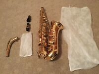 New brass saxophone comes with case, reed, cleaning kit and gloves!