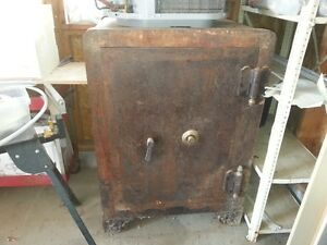SAFE  solid steel with inside shelves. ANTIQUE