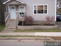 Large2BR Duplex Close to down town area.