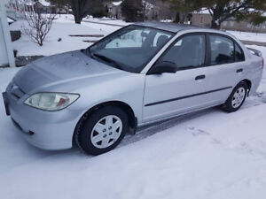 2005 Honda Civic 4 door 5 speed standard.  99600 km. Certified