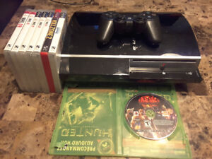PS3 with 8 games and 1 controller.
