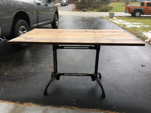 Cast iron and reclaimed wood table