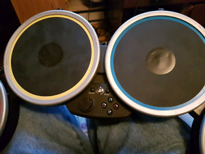 Rock band drums and guitar, no dongle. Asking $20
