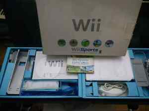Wii System complete in box + Wii Sports , Mario Kart W/ wheel. Kitchener / Waterloo Kitchener Area image 1