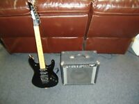 Vantage electric guitar with amplifier