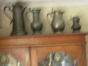 4 early pewter jugs