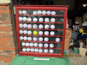 a collection of golf balls in a cool display case