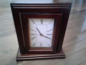 Mantle clock and photo frame for sale.