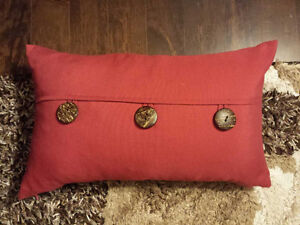 Red decor pillow with buttons