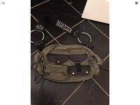 Diesel green bag with lots of pockets. Excellent condition