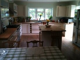 Spacious double room with en-suite, in large village house.