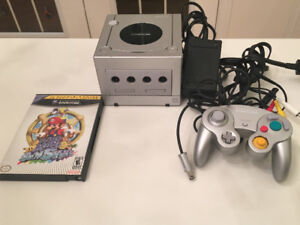 Silver game cube with Mario sunshine game