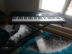 Casio 61 key touch sensitive keyboard and stand
