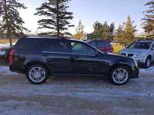 2007 Cadillac SRX AWD  3.6V6. 144,000 KM. $7,900.