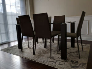 Glass Top Dining Table Set with Six Stackable Dining Chairs