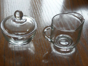 2 glass cleamer and sugar sets