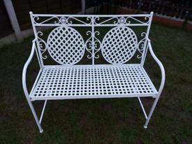 White cast/metal bench
