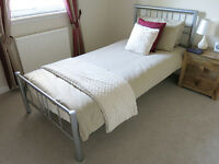 Single Bed with Mattress and Duvet.